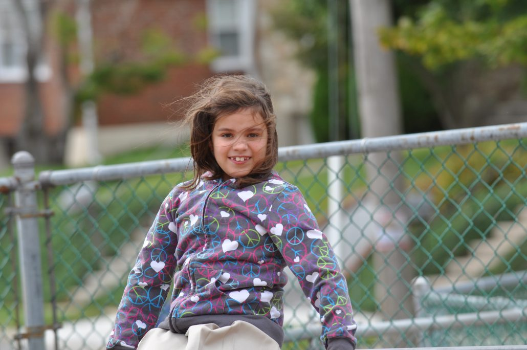 Girl having fun on playground equipment at St Paul Lutheran School Catonsville during After School program