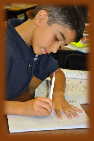 Elementary grade student completing academic work during After School Care at St. Paul Lutheran School Catonsville
